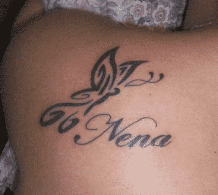 Tribal Name Tattoo For The Back